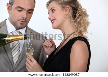 Woman serving champagne - stock photo