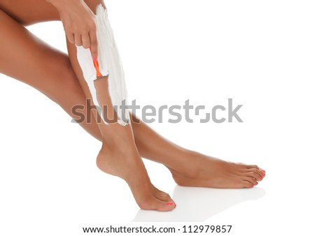 Woman shaving her legs, white background - stock photo