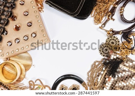 Woman shiny accessories grouped around empty space for text. Top view. - stock photo