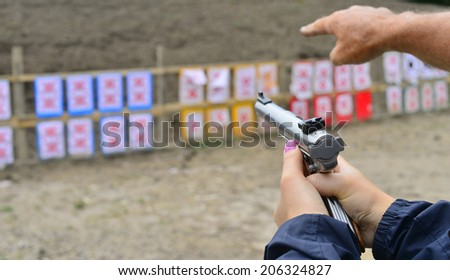 Woman Shooter at the Shooting Range - stock photo