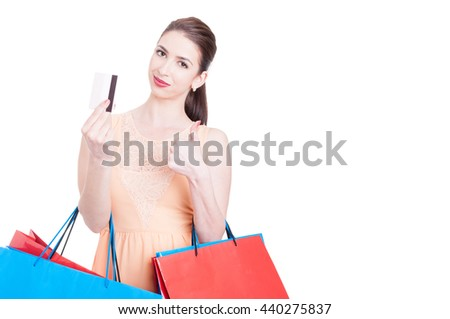 Woman shopper showing credit card and making thumb up gesture isolated on white background with copy text space - stock photo