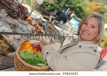 woman shopping at market - stock photo
