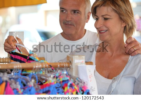Woman shopping for a swimsuit - stock photo