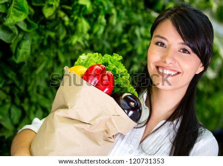 Woman shopping for groceries at the marketplace - stock photo