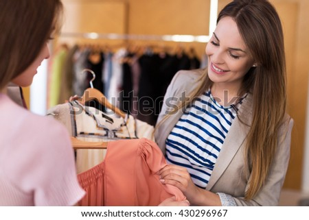 Woman shopping in a boutique  - stock photo