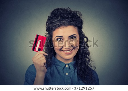 woman shopping on line holding showing credit card - stock photo