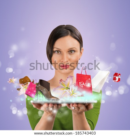 Woman shopping online using her tablet computer - stock photo