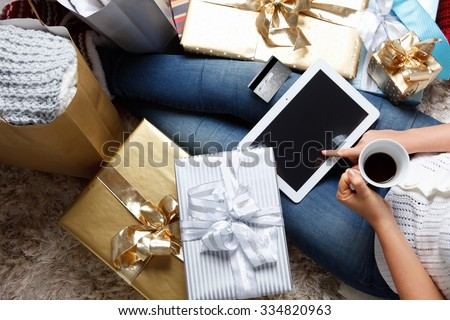 Woman shopping online with a credit card - stock photo