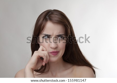 woman shot in the studio making different expressions  - stock photo