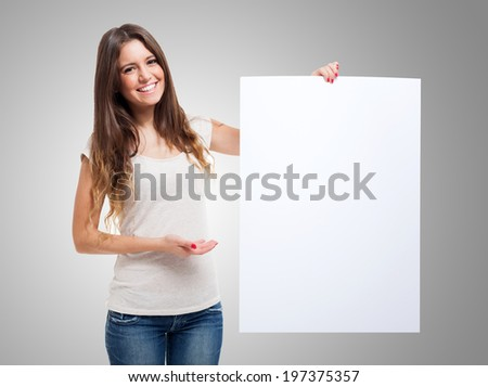 Woman showing a blank white board - stock photo