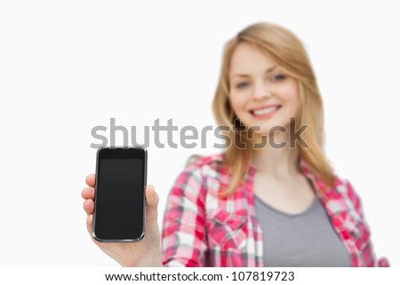 Woman showing a smartphone against a white background - stock photo