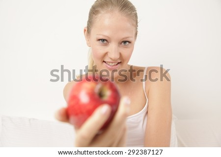 Woman showing an apple - stock photo