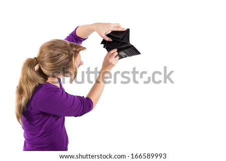 Woman showing an empty wallet - stock photo