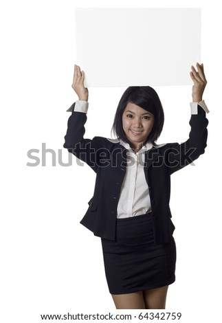 Woman showing and holding up over her head a blank billboard sign banner - stock photo