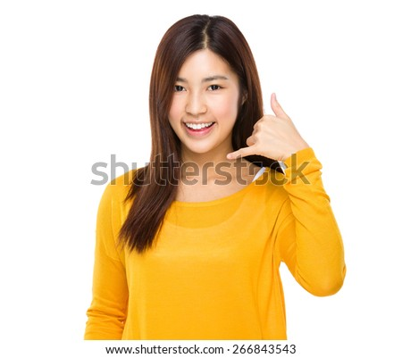 Woman showing call me phone hand sign smiling happy - stock photo