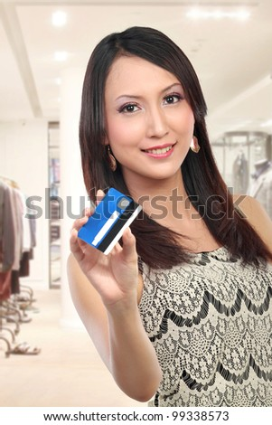 woman showing  credit card for shopping - stock photo