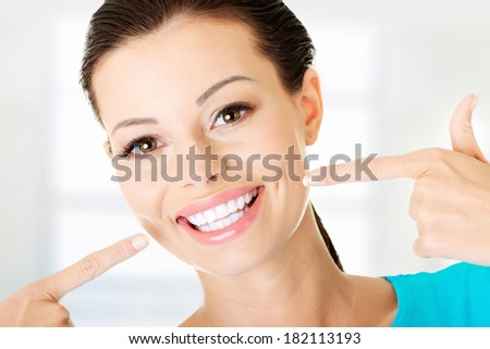Woman showing her perfect straight white teeth.  - stock photo