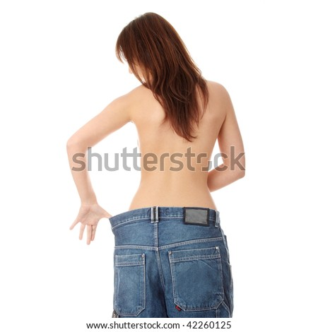 Woman showing how much weight she lost. Isolated - stock photo