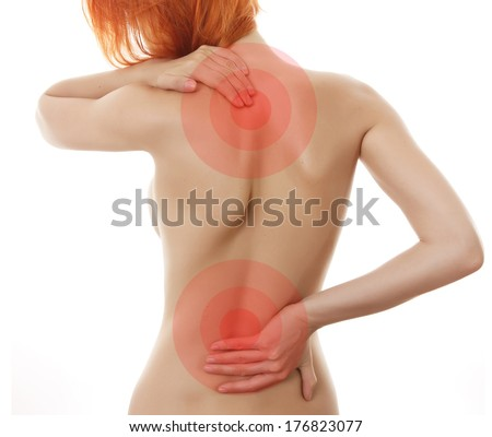 Woman showing pain in back .Medical concept - stock photo