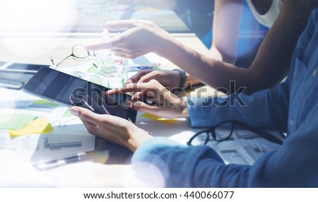 Woman Showing Screen Digital Tablet Hand.Project Managers Researching Process.Business Team Working Startup modern Office.Analyze market stock.Using electronic devices,papers,notes wood table.Blurred - stock photo