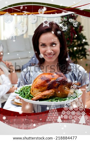 Woman showing to the camera Christmas turkey against snow falling - stock photo