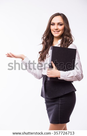 Woman showing your product or message smiling happy isolated on white background in studio. Beautiful  business girl  showing open hand palm. - stock photo