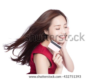 woman shows her credit card ,putting her hand on her face,asia beauty - stock photo