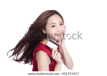 woman shows her credit card , putting her hand on her face,asia beauty - stock photo