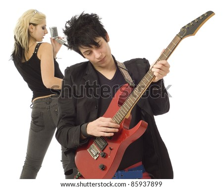 Woman singer and male guitarist playing in garage band isolated on white - stock photo