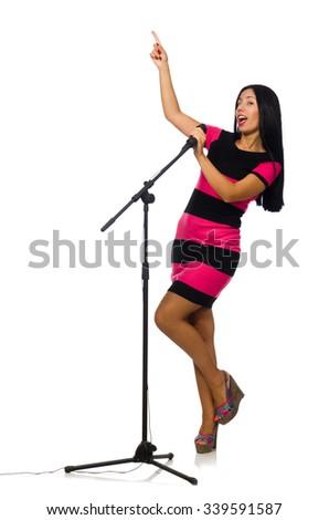Woman singing in karaoke club on white - stock photo