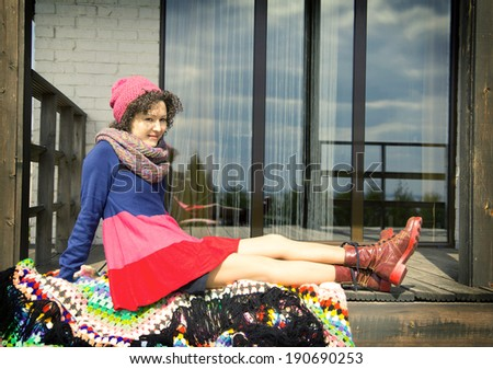 woman sits on a terrace - stock photo