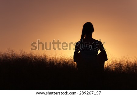 Woman sitting and enjoying the view. - stock photo