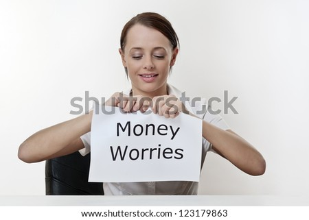 woman sitting at a desk about to get rid of all her money worries - stock photo