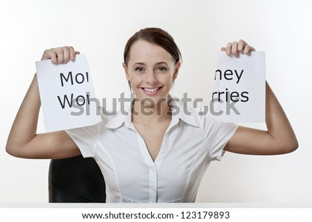 woman sitting at a desk with no money worries - stock photo