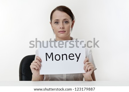 woman sitting at a desk worried about money problems - stock photo