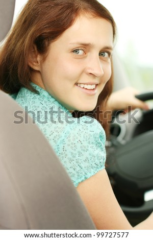 Woman Sitting In Car Getting Ready To Drive - stock photo