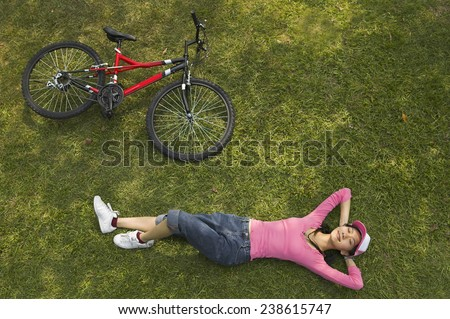 Woman Sitting in the Grass - stock photo