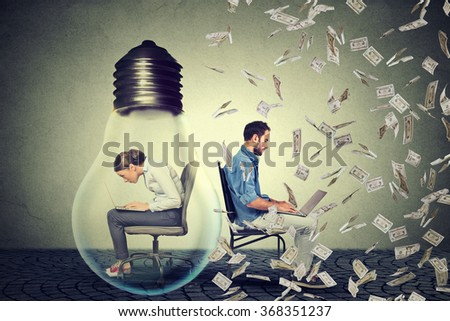 Woman sitting inside electric lamp using working on computer in corporate office next to young entrepreneur man under money rain. Company employee vs startup concept. Pay compensation difference idea - stock photo