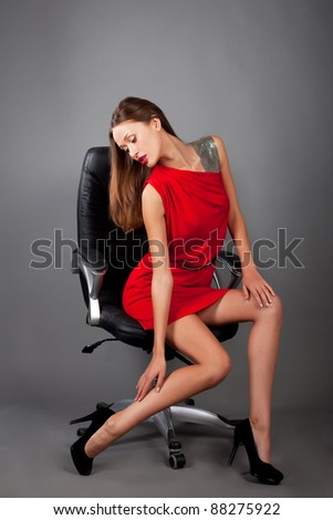 woman sitting on a chair - stock photo