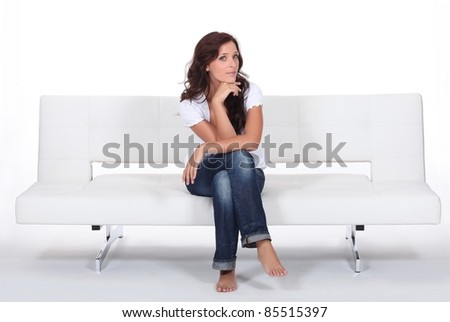 woman sitting on a couch - stock photo