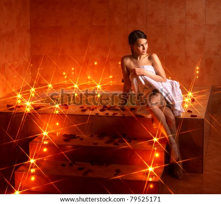 Woman sitting on edge of bath tub. - stock photo