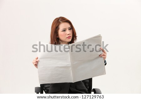 woman sitting on the chair reading paper - stock photo