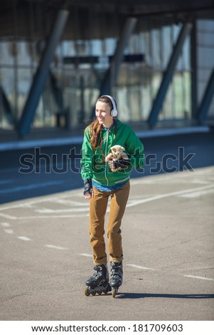 Woman skating in the park. Sporty woman in outdoor fitness activities - stock photo