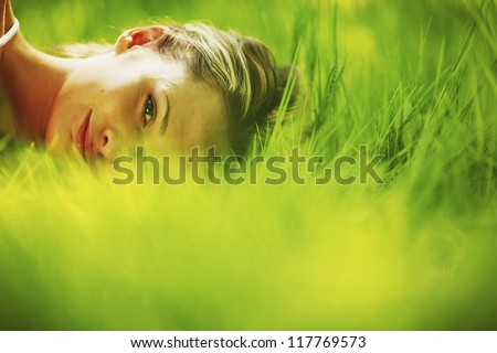 woman sleep on green grass - stock photo