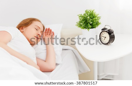 woman sleeping in a bed at home - stock photo