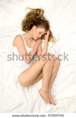 Woman sleeping on the bed - stock photo