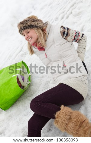 Woman Slipped And Injured Back On Icy Street - stock photo