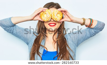 Woman smile with teeth. Two cake. Diet concept. Lon hair model. - stock photo