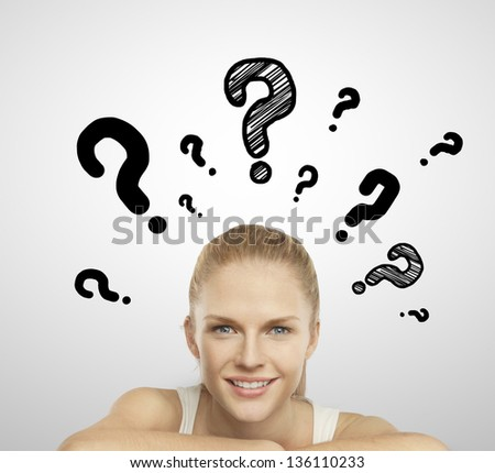 woman smiling and question mark over head - stock photo