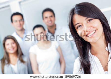 Woman smiling at the hospital with medical staff - stock photo